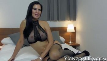 Petite brunette fingers her pussy on coffee table